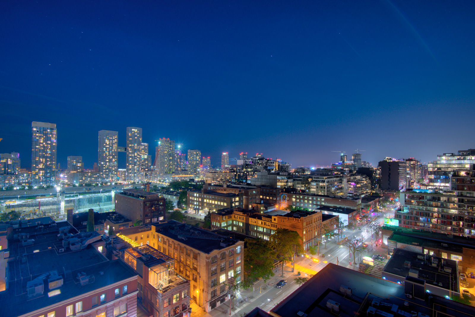Night view of King St W from roof of Victory Lofts Penthouse Suite in 478 King St W Toronto.