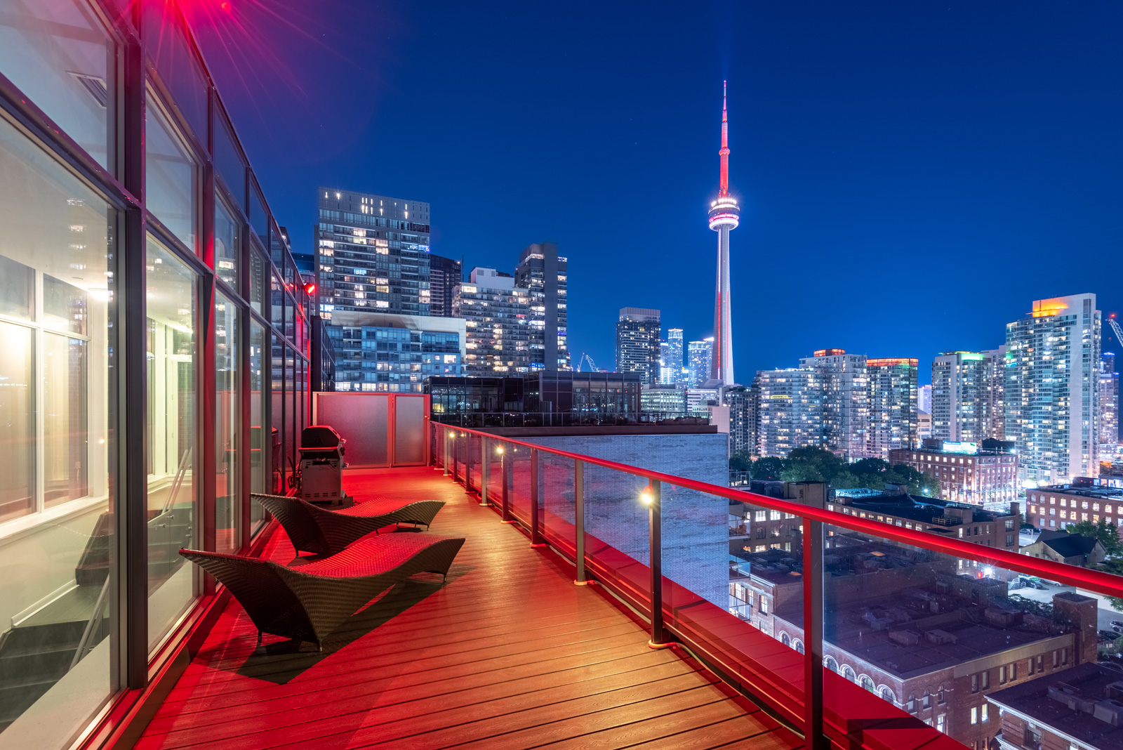 Photo of CN Tower and Toronto at night from Victory Lofts Penthouse Suite in 478 King St W Toronto.