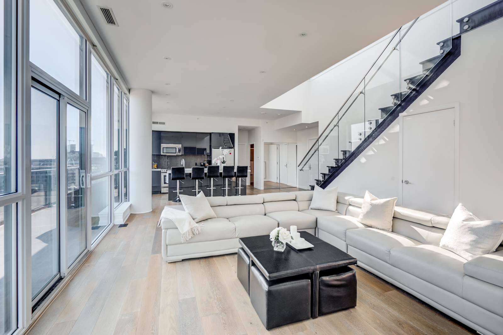 Living room and kitchen photo of Victory Lofts - 478 King St W Toronto Penthouse Suite