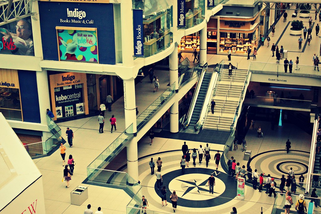 Top-down view of stores and shoppers at Eaton Centre in Toronto.