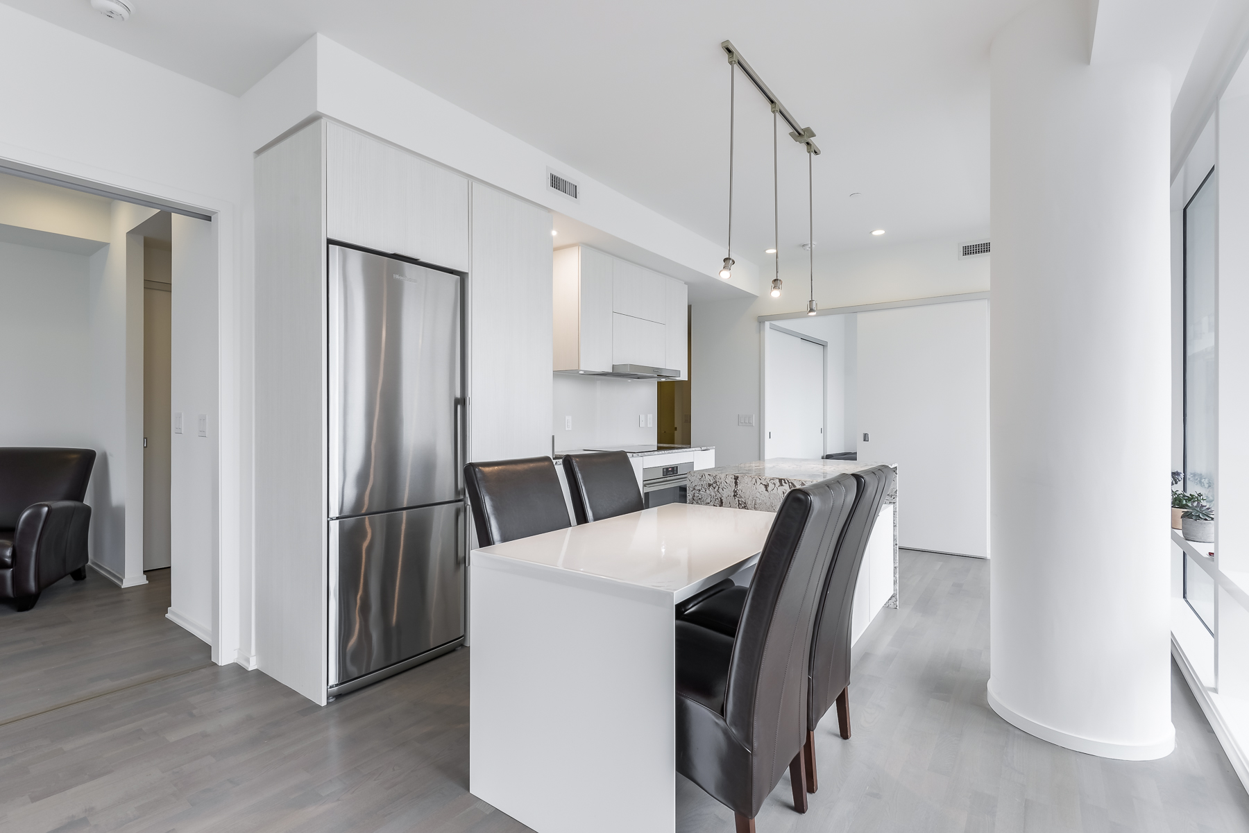 View of white and gray colours in 1 Bloor St E Unit 310 Toronto.