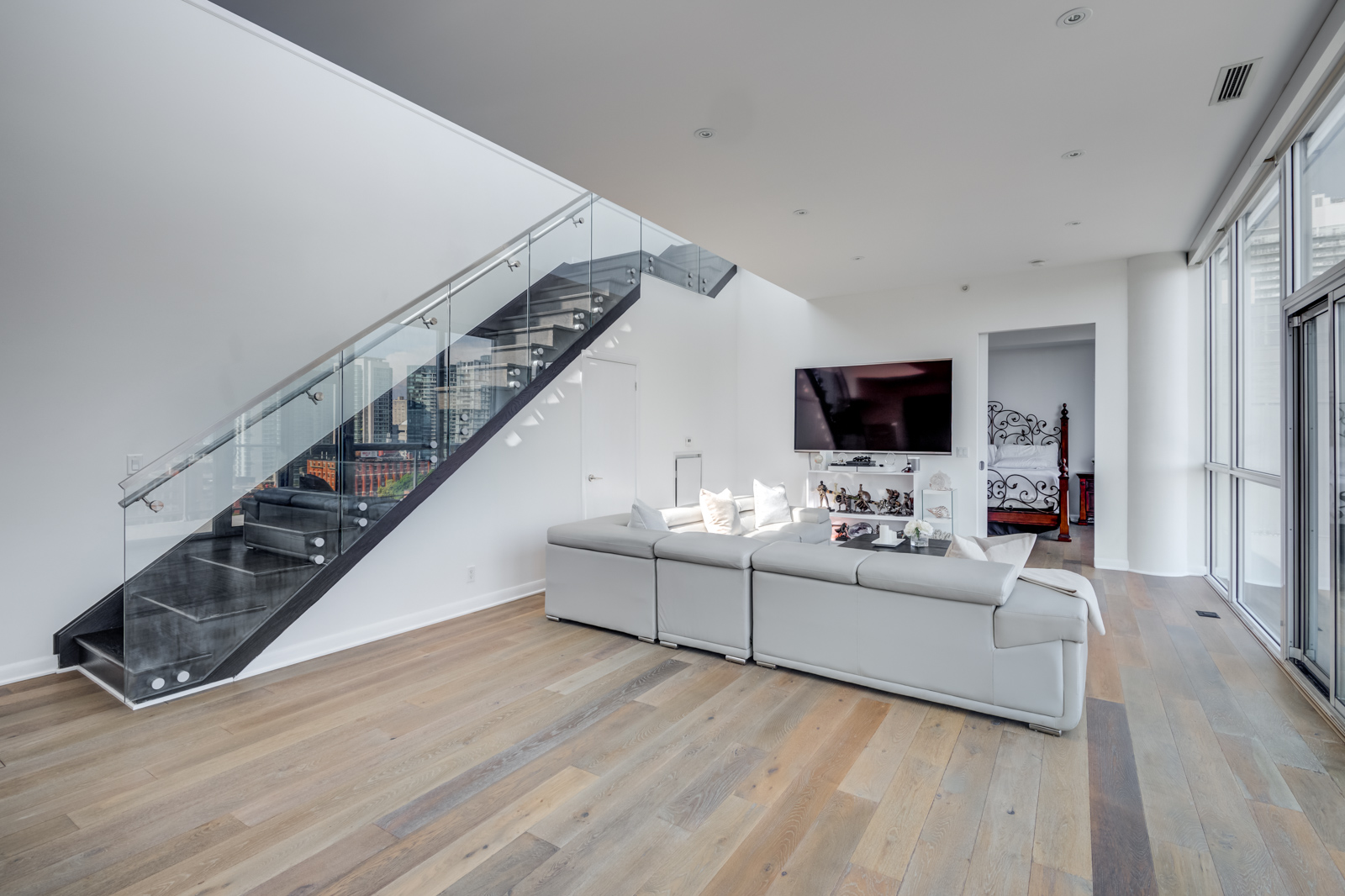 Glass staircase in Victory Lofts - 478 King St W Toronto Penthouse Suite.