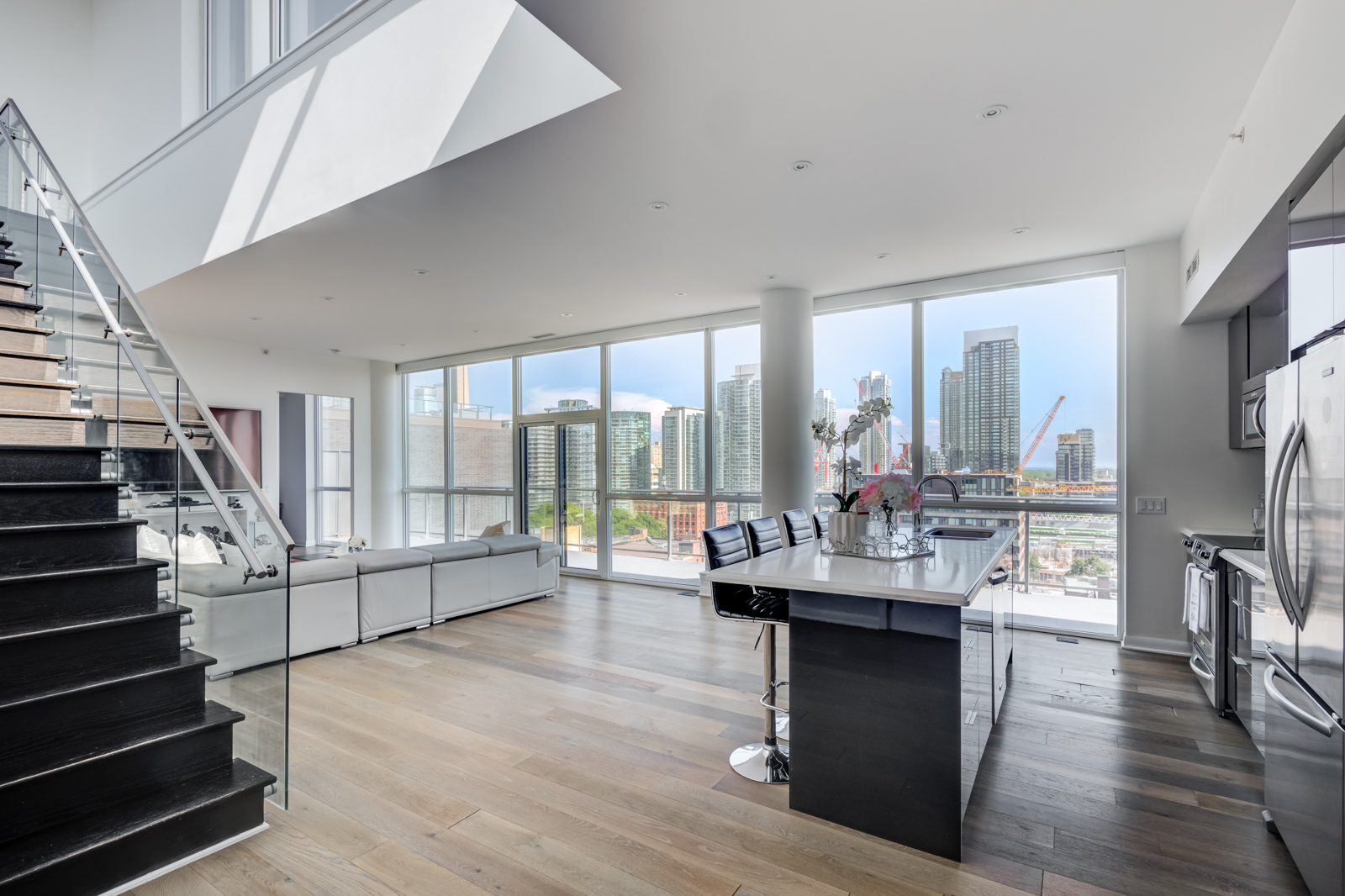 Large, floor-to-ceiling windows at Victory Lofts Penthouse Suite in 478 King St W Toronto.