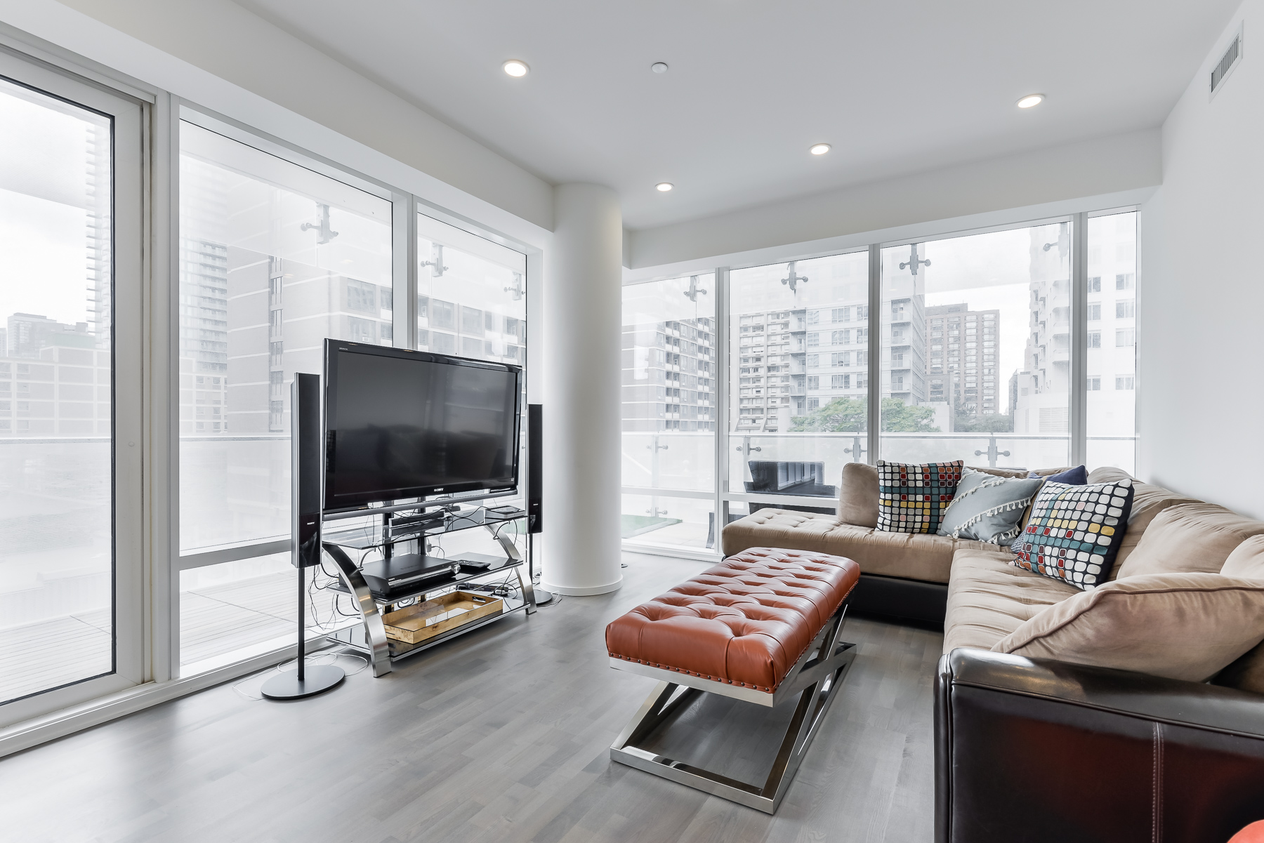 Another shot of living room and furniture of 1 Bloor St E Unit 310 Toronto.