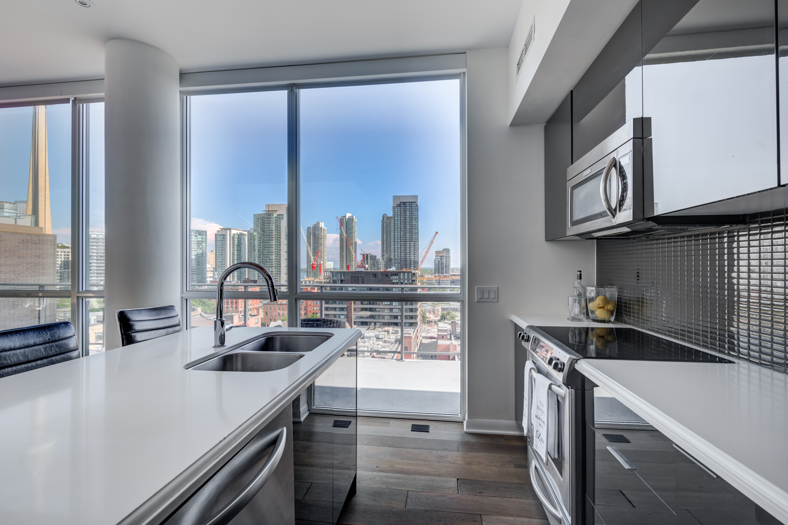 View of Toronto from kitchen windows of Victory Lofts Penthouse Suite in 478 King St.