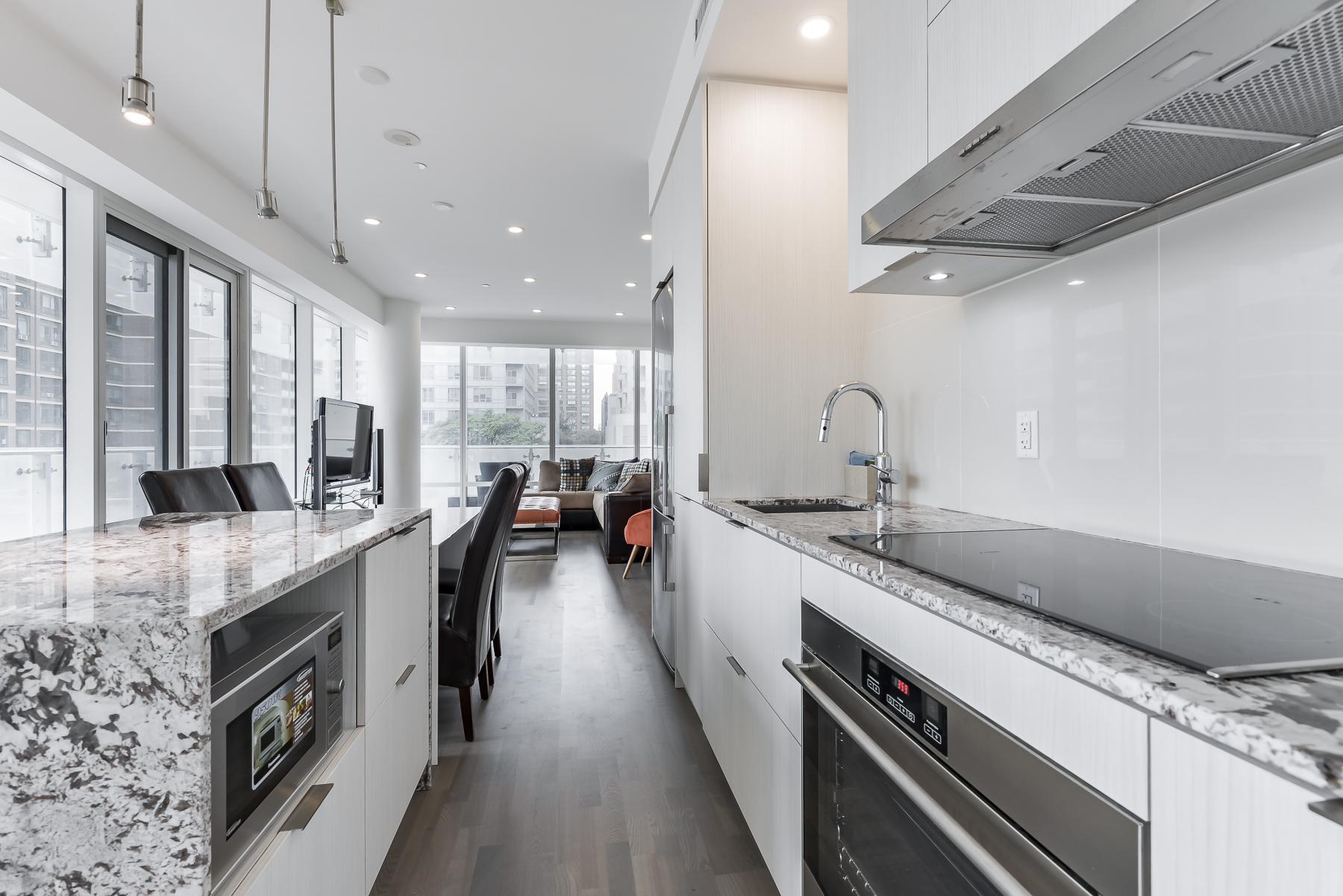 Close up of kitchen, island and appliances at 1 Bloor St E Unit 310 Toronto.