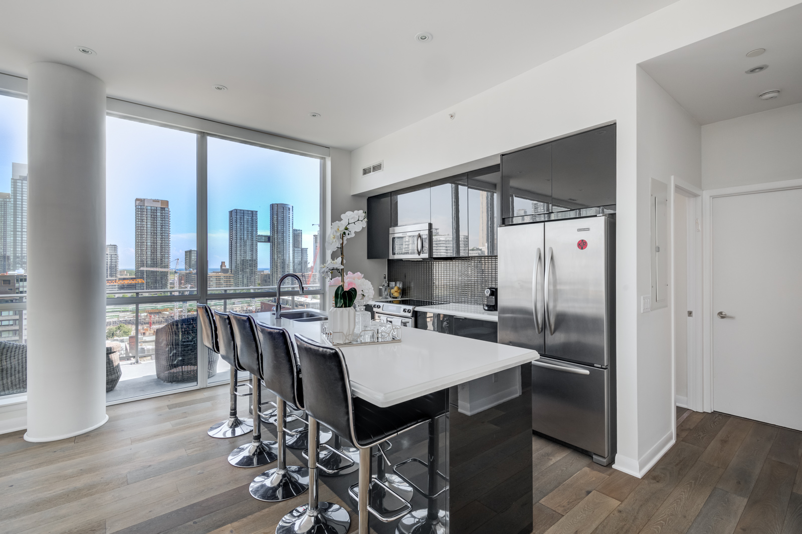 Breakfast bar and kitchen island with stools - Victory Lofts Penthouse Suite in 478 King St W Toronto.