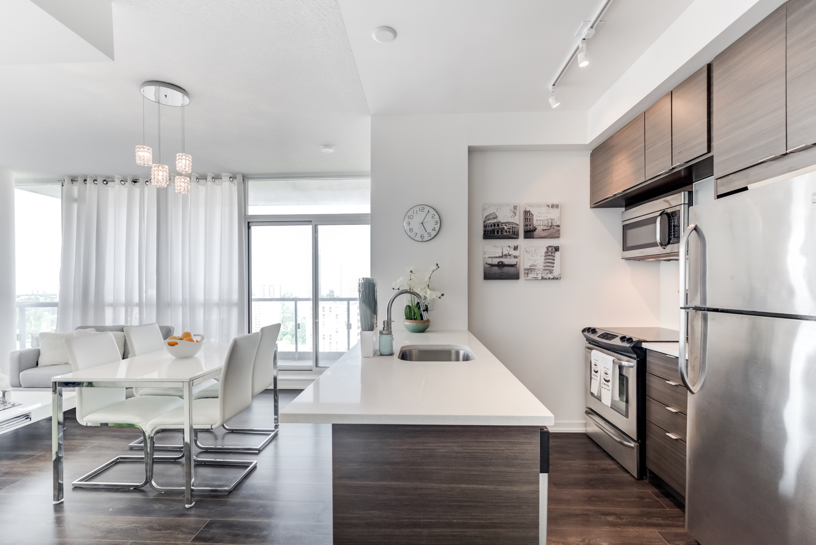 Breakfast bar with dark base and view of kitchen cabinets and appliances at 62 Forest Manor Rd Unit 1803, Toronto.