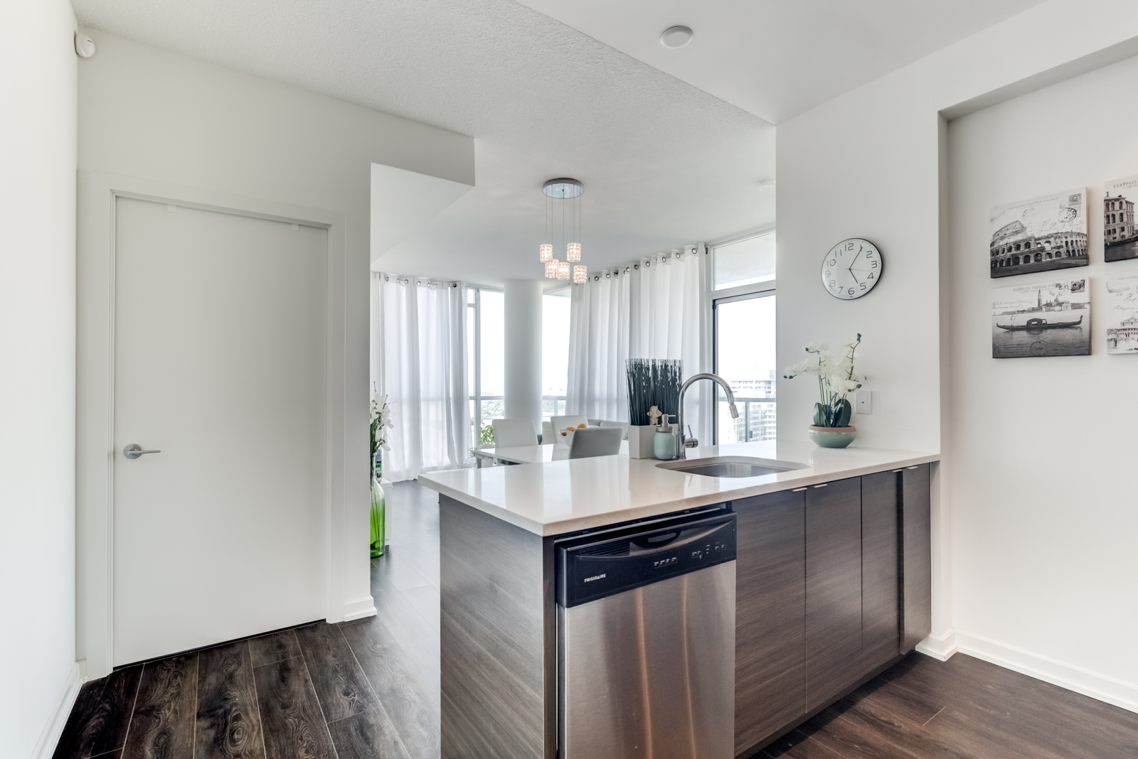 Kitchen breakfast bar with built-in dishwasher at 62 Forest Manor Rd Unit 1803, Toronto.