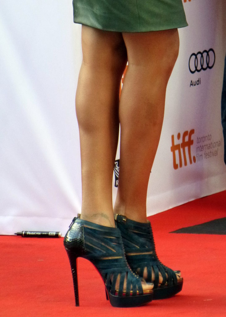 Female figure showing legs and leather shoes at Toronto International Film Festival