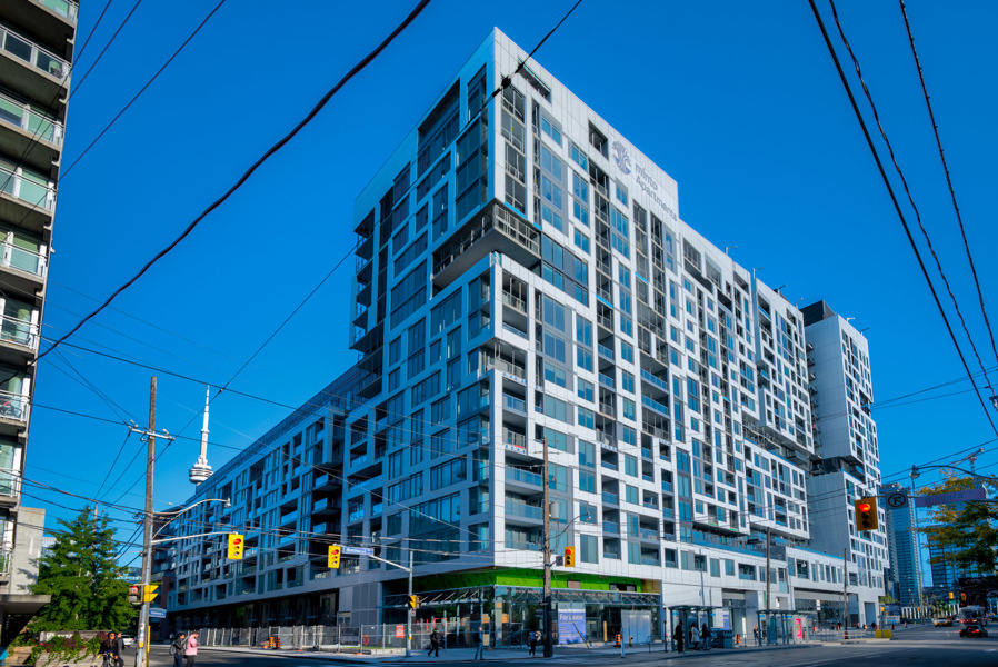 Exterior of Minto Condos at the corner of Front St and Bathurst in King West, Toronto.