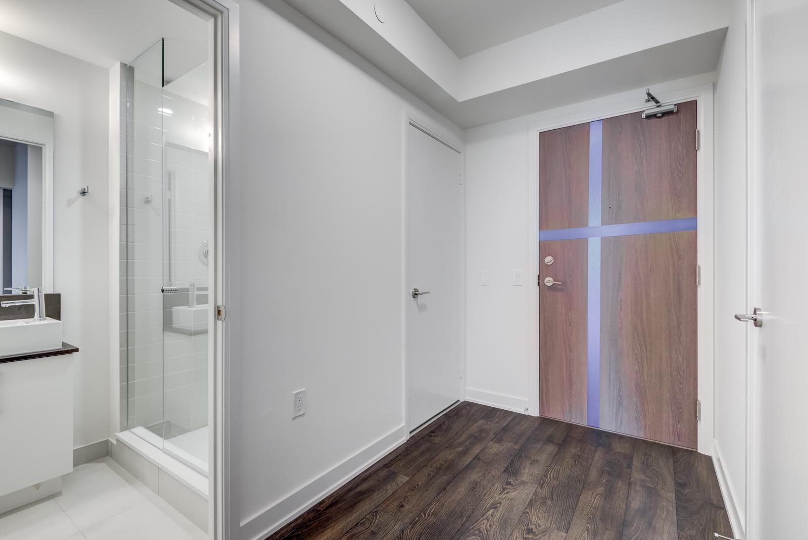Second bathroom with open door; hallway and front entrance.