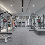 Modern gym with weights, treadmills, exercise bikes and exercise balls.