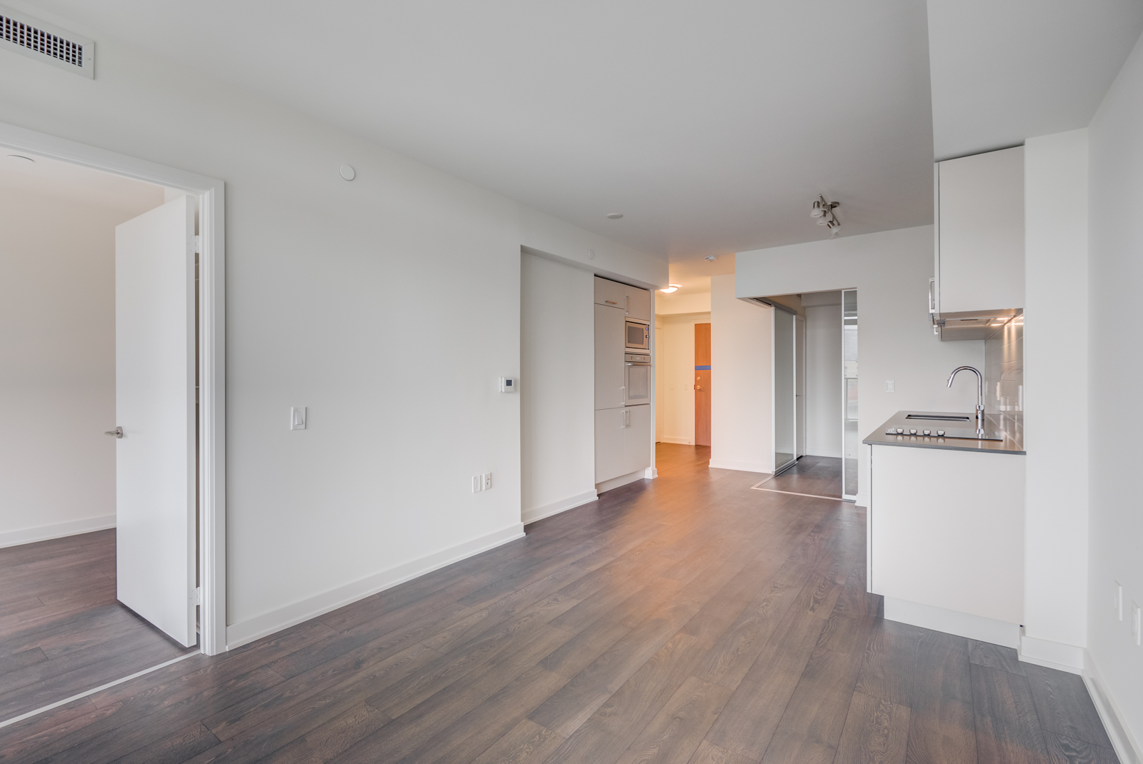 Spacious open-concept living and dining rooms with kitchen.