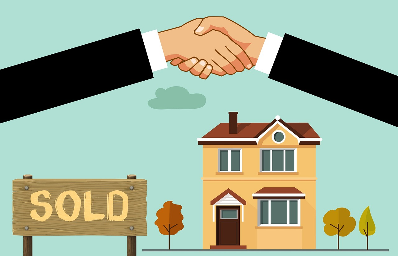 Animated handshake over house and sold sign.