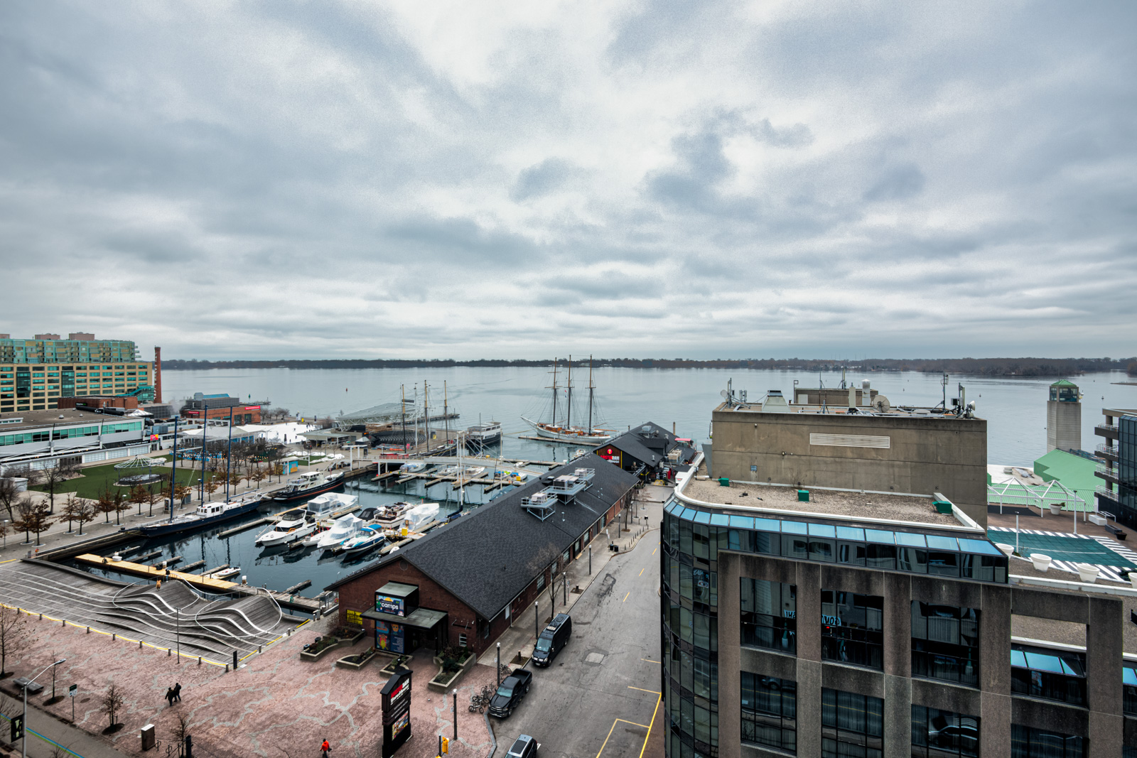 View of Toronto Waterfront, pier with boats, Lake Ontario and streets below Harbourfront II.