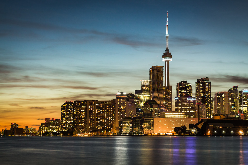Toronto skyline from Lake Ontario showing CN Tower and other buildings in the GTA real estate market.