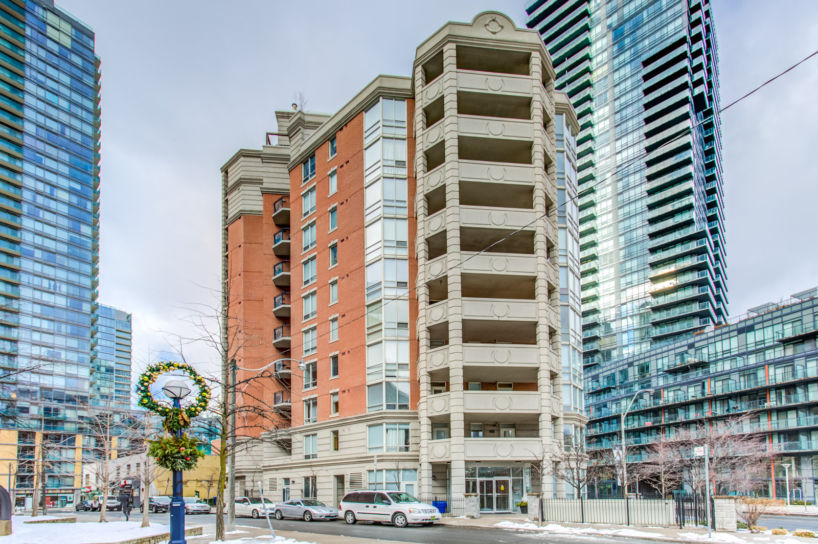 View of 20 Collier St, a 13-storey boutique condo of redbrick and gray stone.