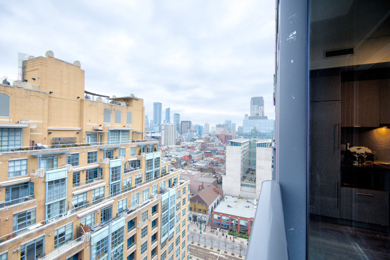 The penthouse suite balcony showing buildings and streets of the Fashion District.