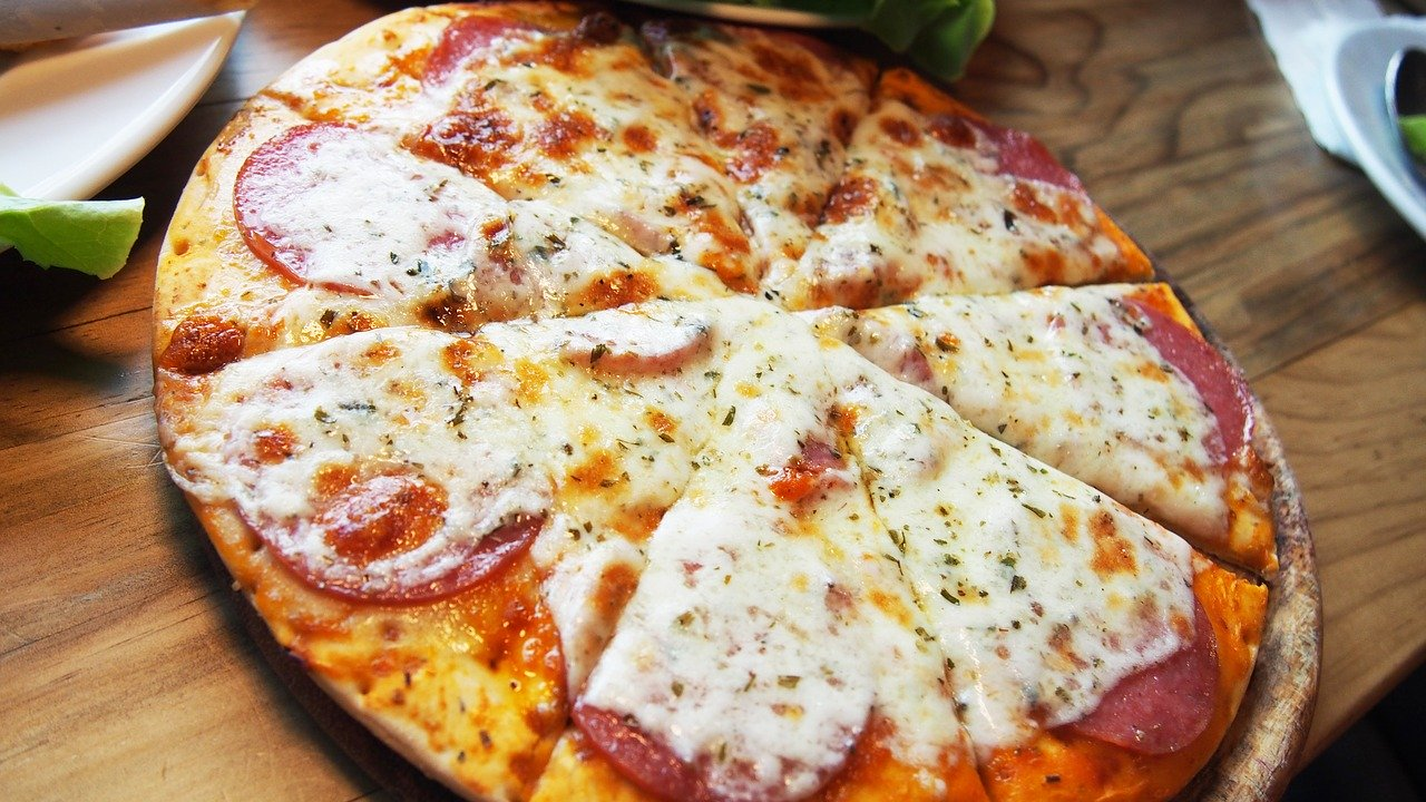 Close up of pizza with white Italian cheese and pepperoni.