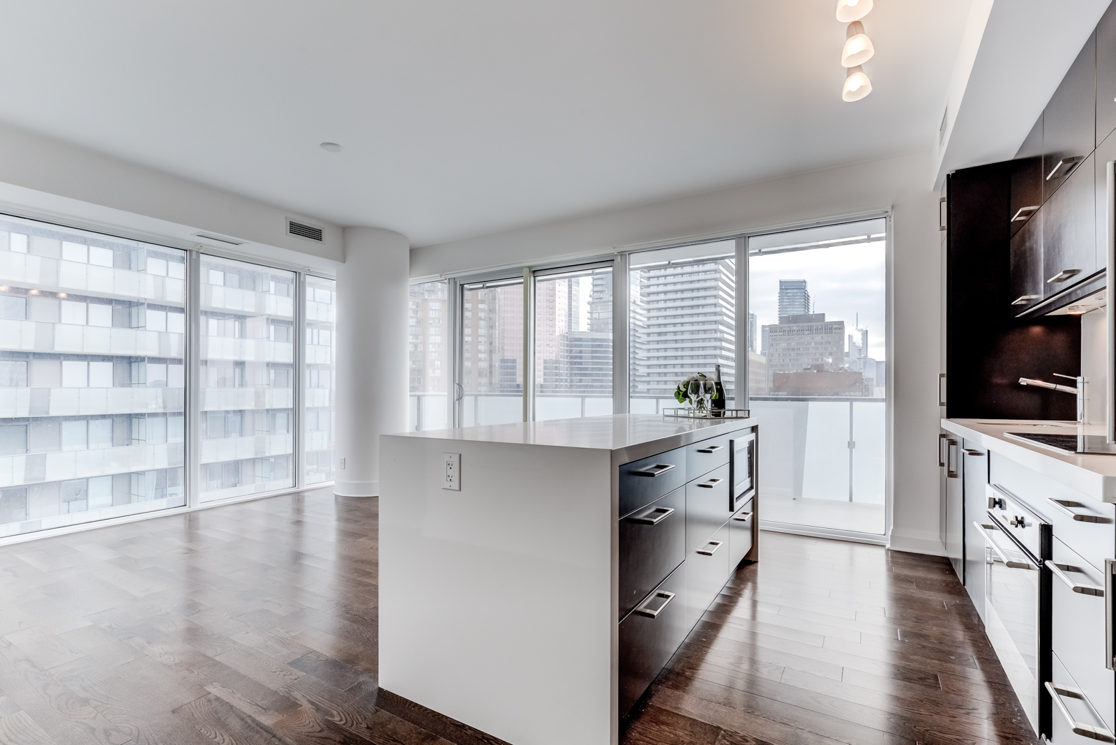 Empty living and dining room of U Condominiums at 65 St Mary St Unit 1502, the third most expensive property I sold.