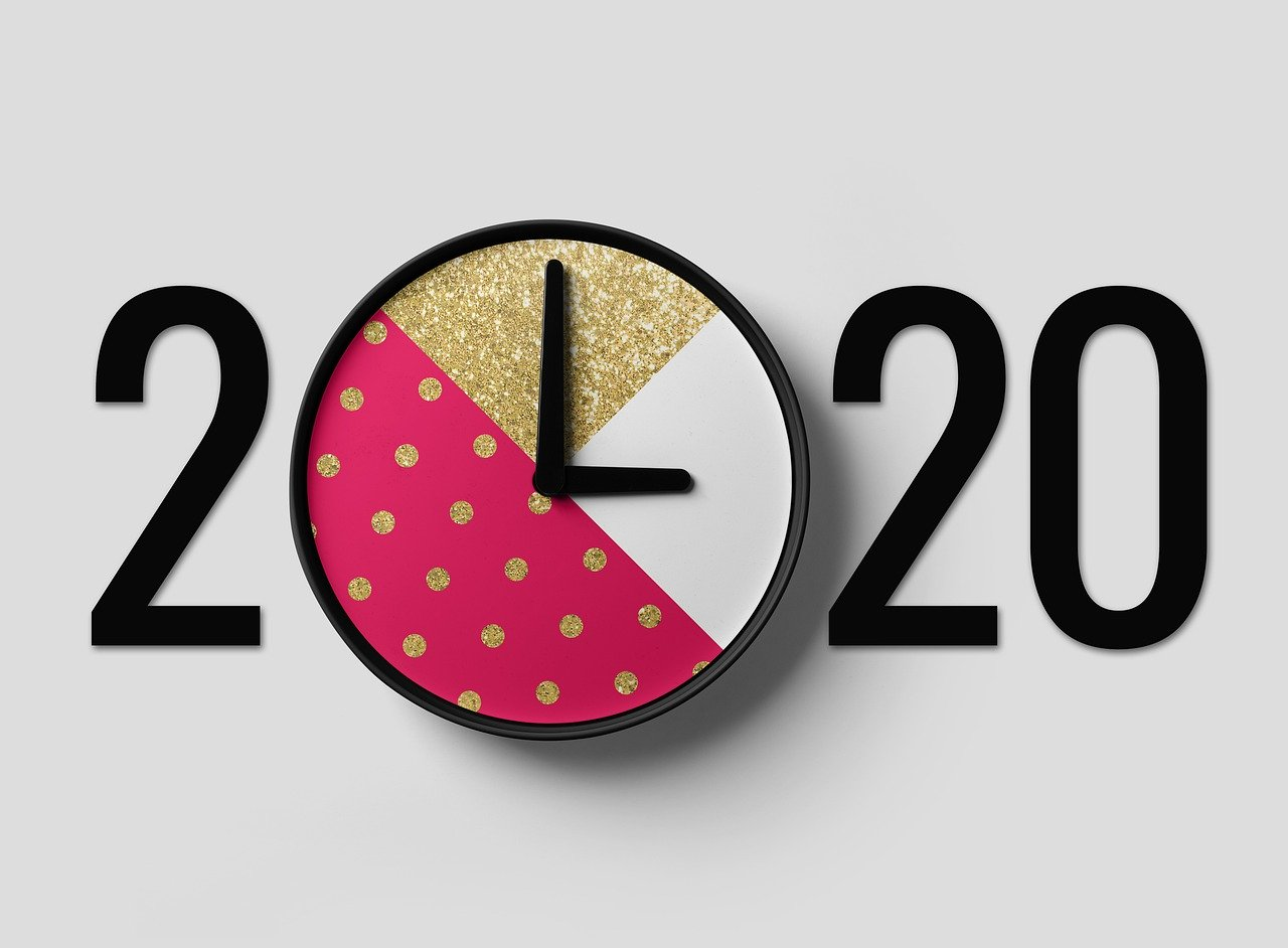 Numbers 2020 with analog clock standing in for first zero in 2020.