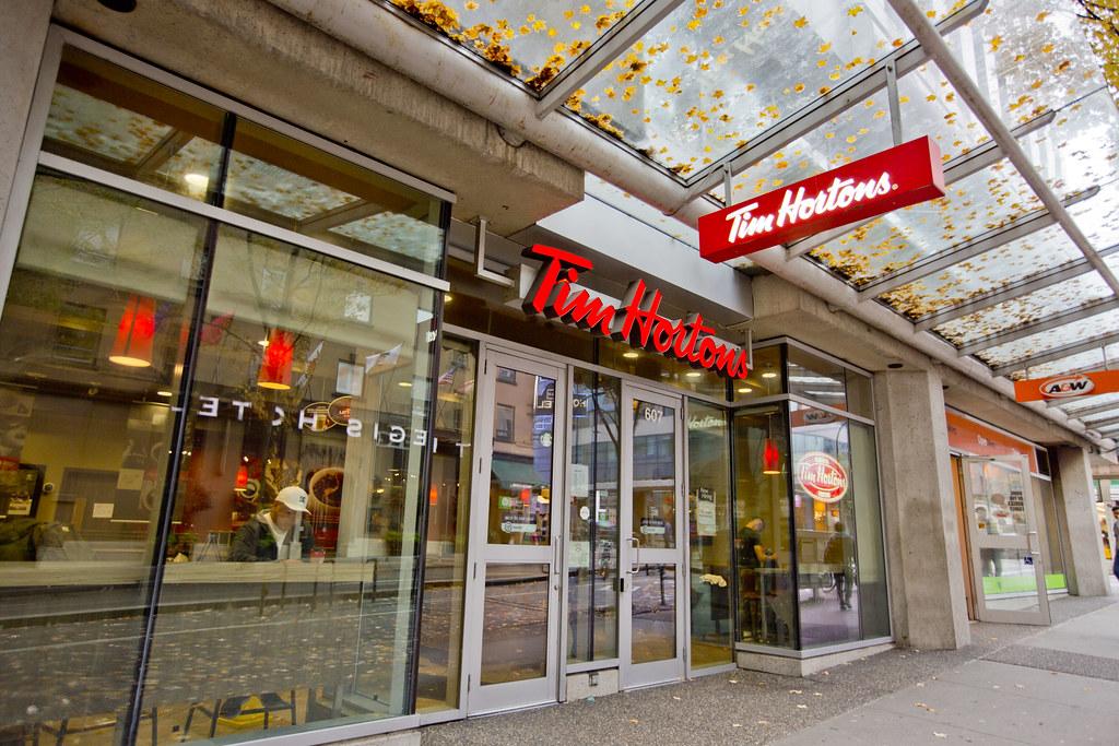 Tim Hortons exterior in autumn along Church-Yonge Corridor in Toronto.