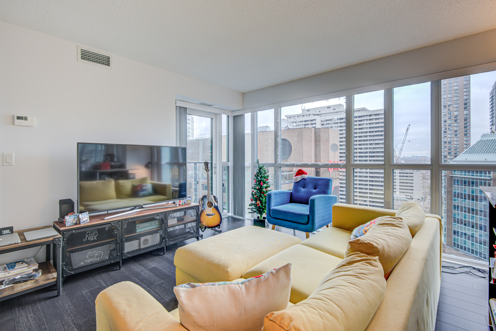 Open-concept living room and dining room at 28 Ted Rogers Way Unit 1702.