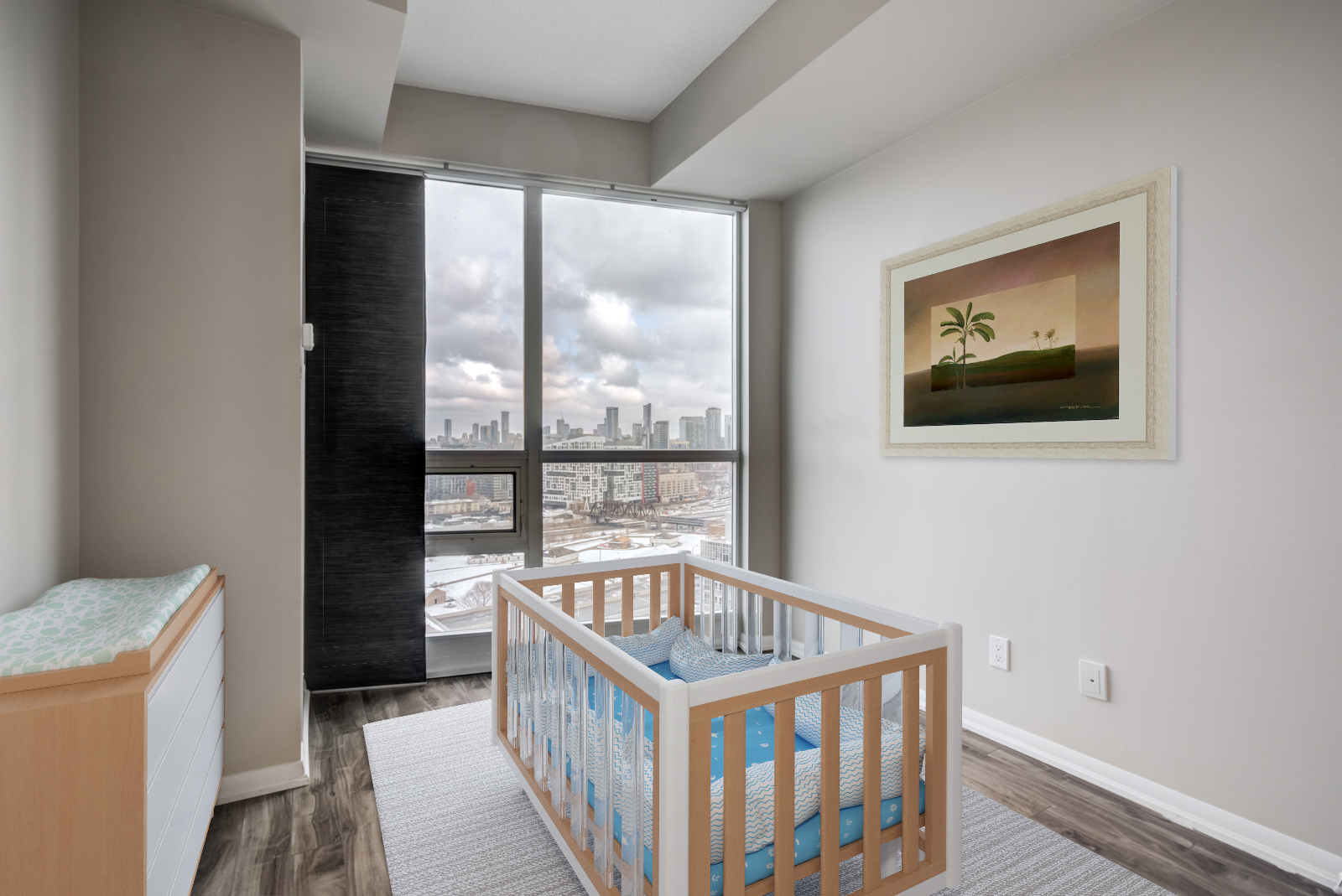 Nursery with 3D crib and painting at 215 Fort York Blvd #2310.