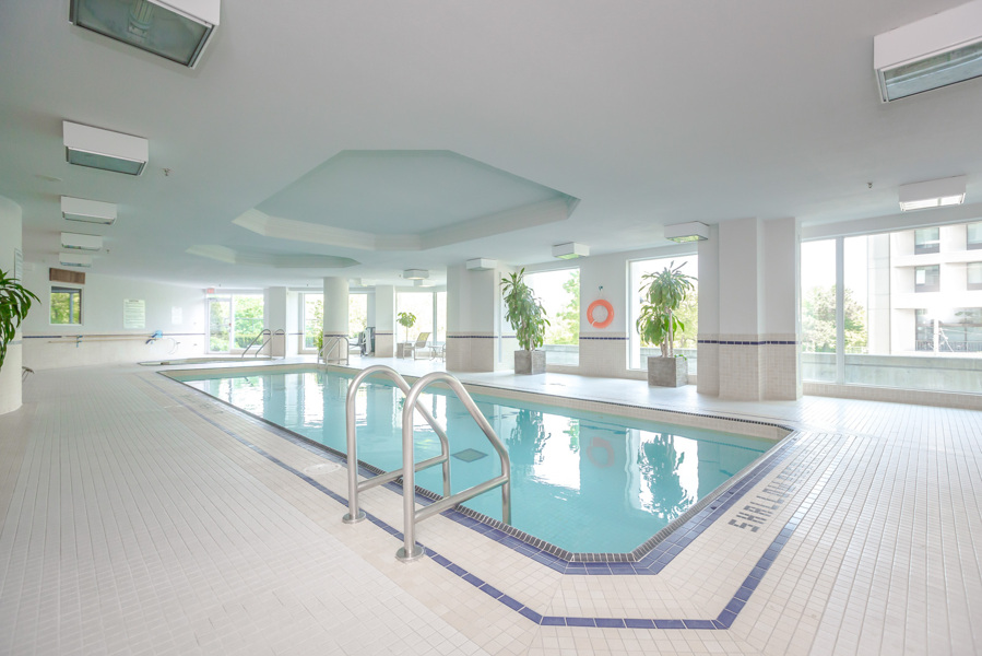 Indoor swimming pool and salt water pool in white facility at Bellagio on Bloor Condos, Toronto.