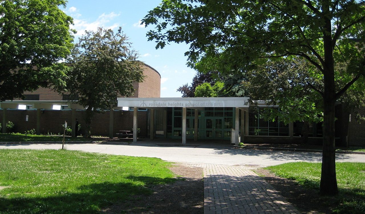 Facade and tree-lined path outside Rosedale Heights School of Arts in Toronto.