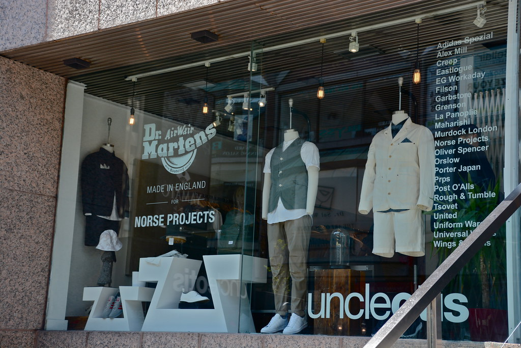 Storefront display of stylish male mannequins in Yorkville, Toronto.