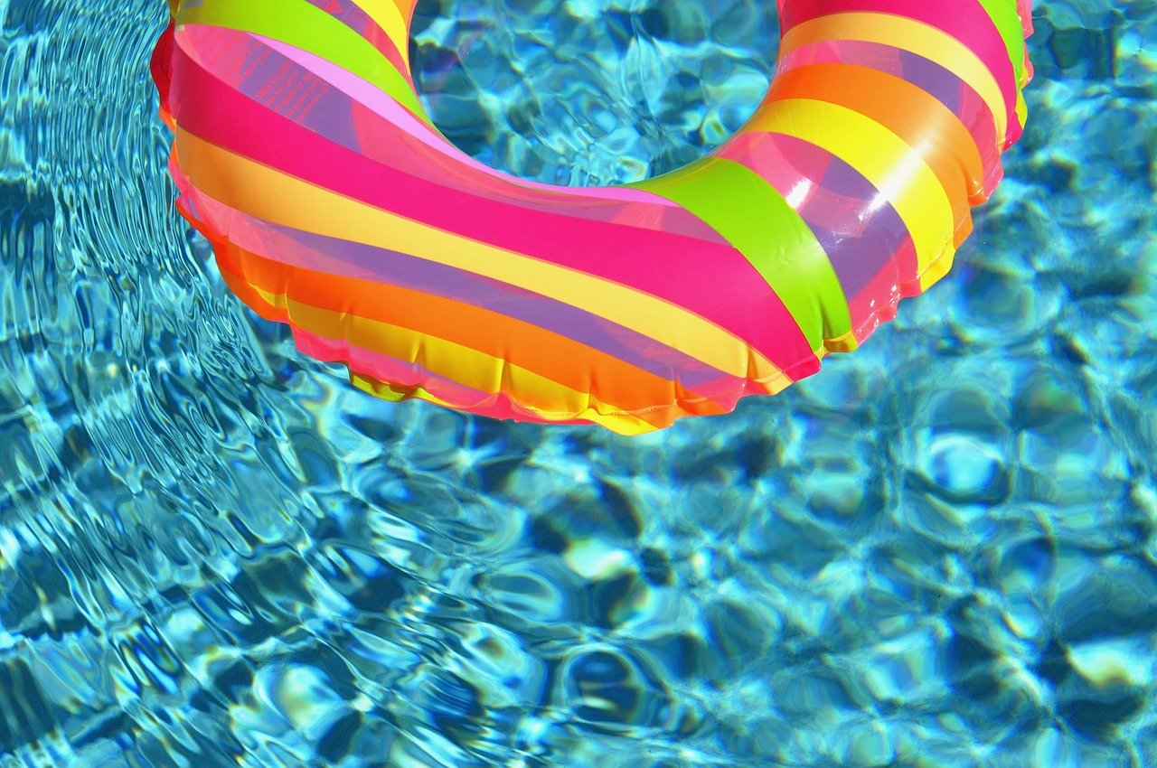 Close up of swimming pool with colourful flotation ring.