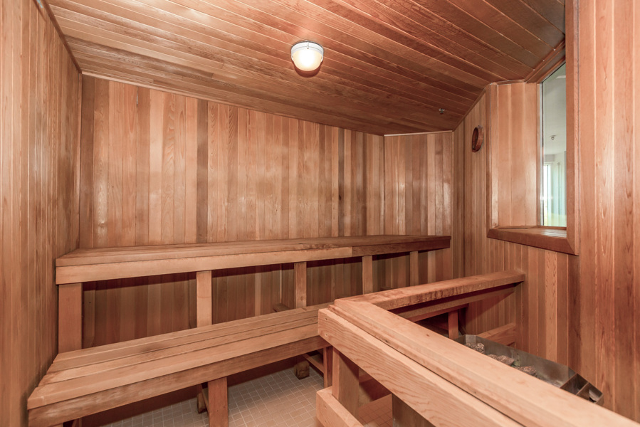 Sauna with wood panelling and benches in the Bellagio on Bloor.