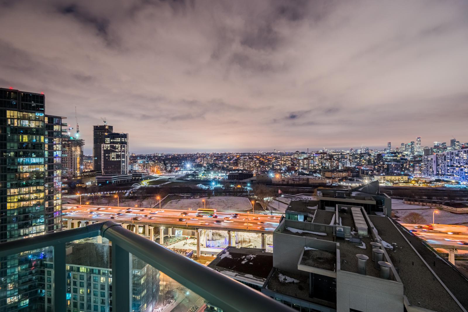 City lights of Fort York, Toronto at night from 215 Fort York Blvd Unit 2310 balcony.