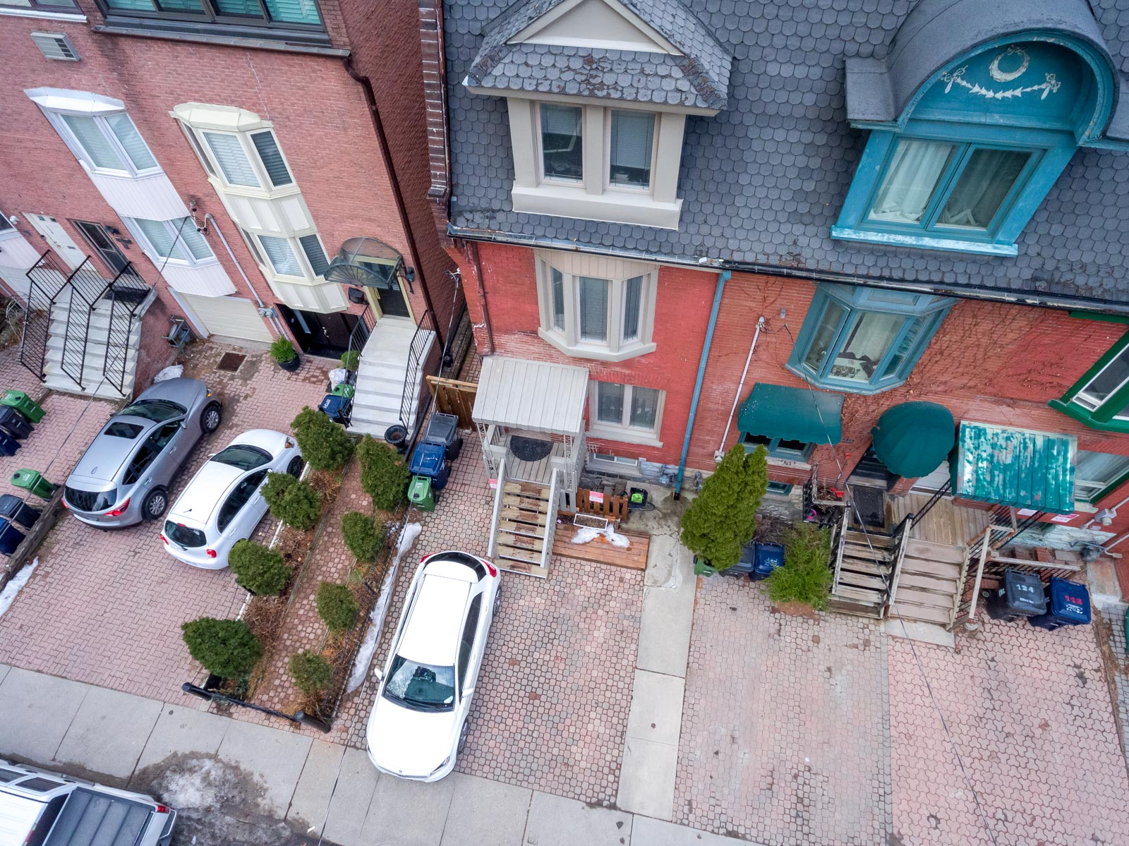 Drone photo of 120 McGill St, a red-brick Victorian house.