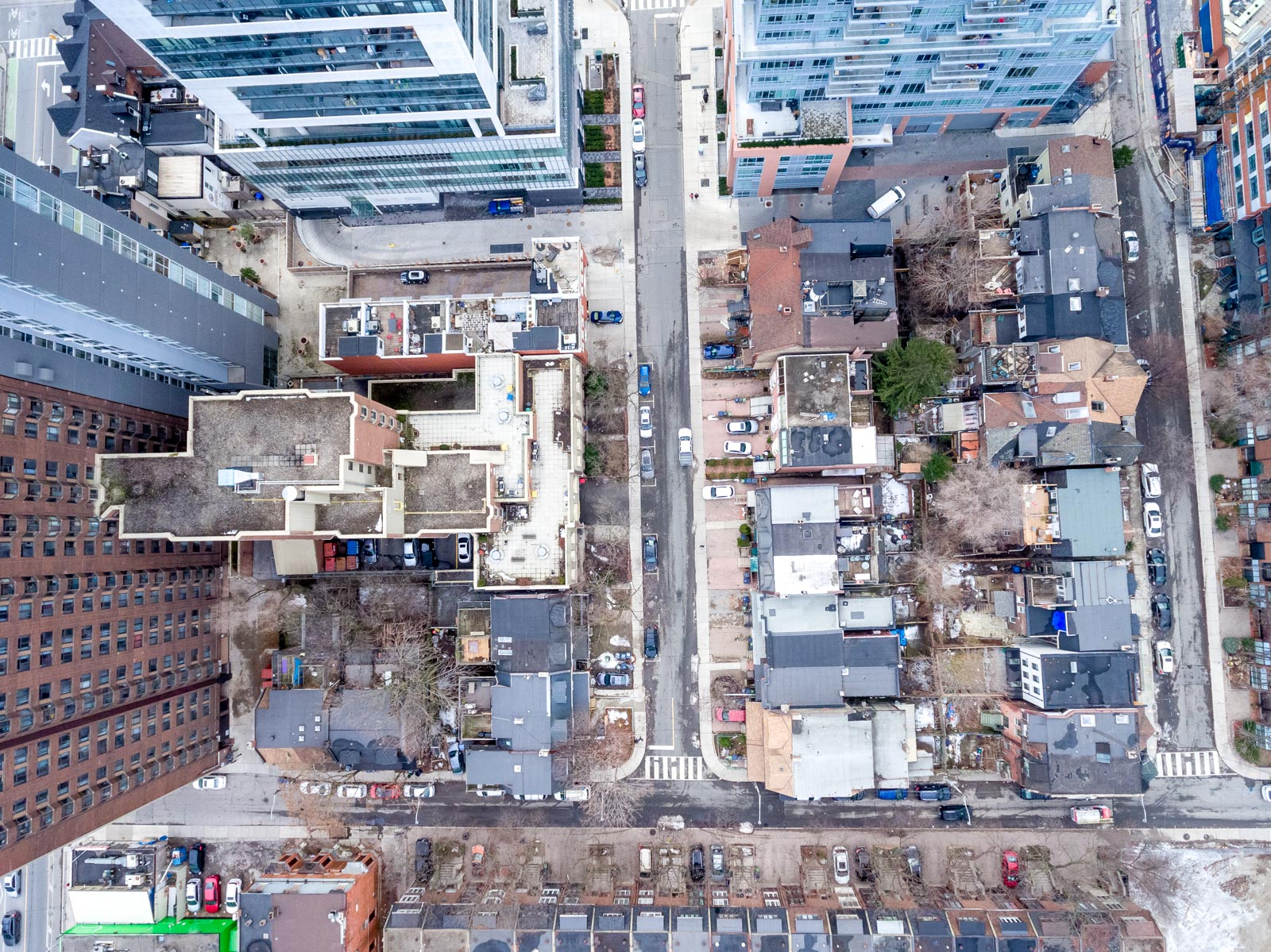 Drone photo of 120 McGill St, Victorian house, surrounded by tall buildings in Toronto.