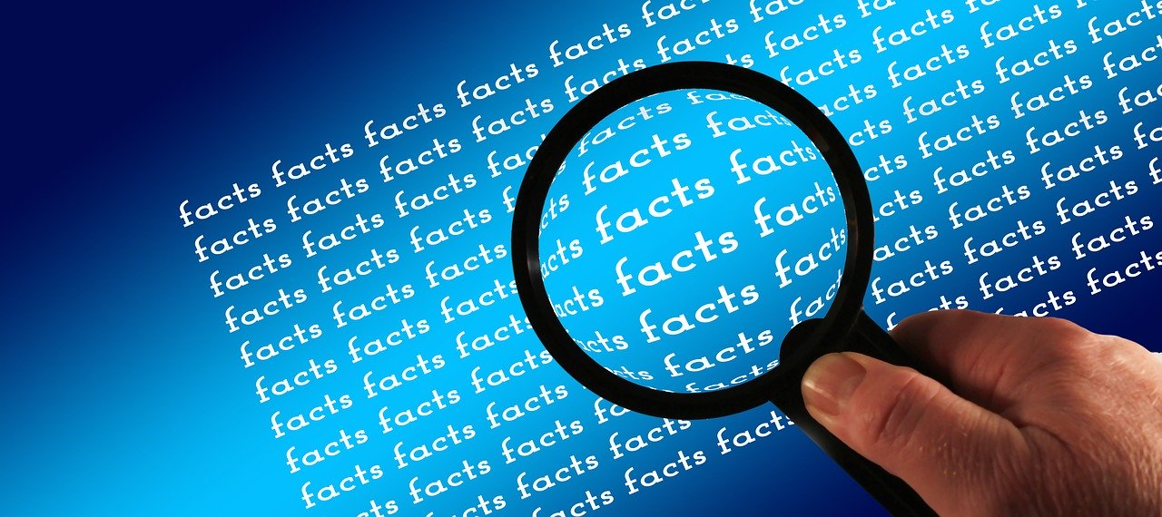 """Black magnifying glass examining the word """"facts"""" showing facts behind 2020 spring market."""