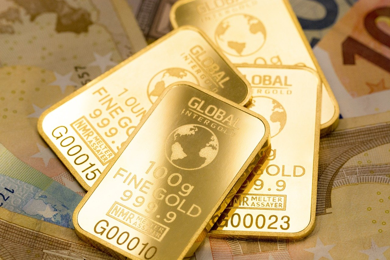 Thin gold bars etched with purity level, company name and numbers.