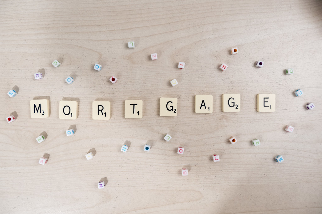 """Beige scrabble tiles spelling out word """"Mortgage."""""""