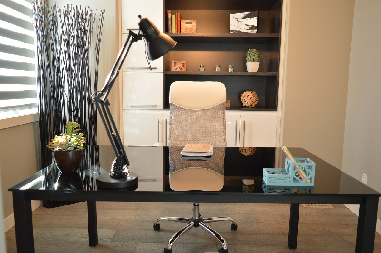 12A Cecil den being used as a home office with desk, chair and table lamp.