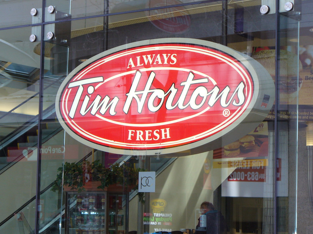 "Large red and white Tim Hortons sign saying ""Always Fresh."""