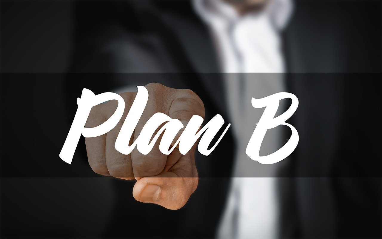 Ask an expert finger pointing at word plan.