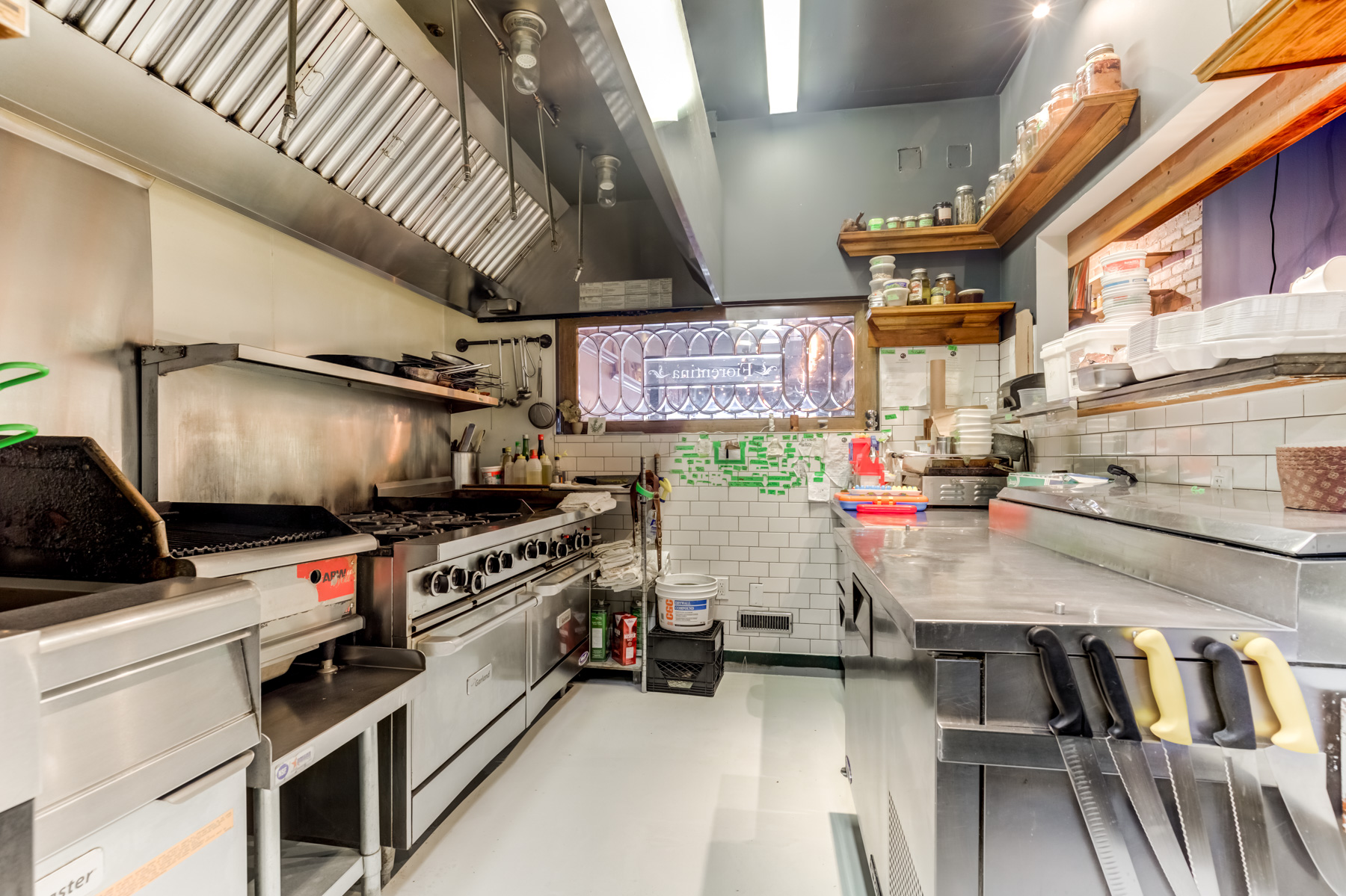 Restaurant kitchen with industrial stove.
