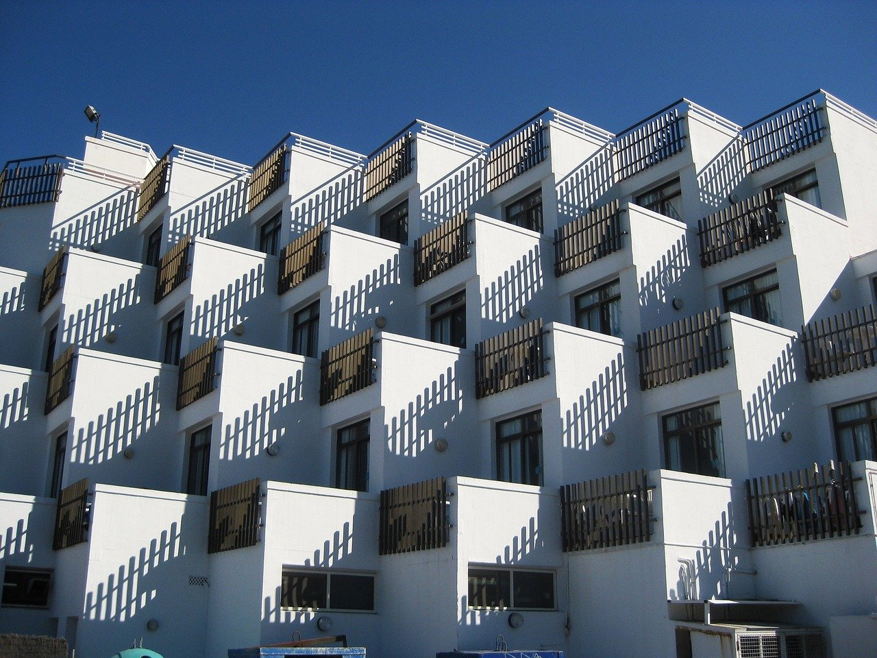 Tiny stacked apartments showing Simply Home Downsizing challenge of decorating micro condos.